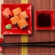 Portion of rolls with soy sauce, ginger, wasabi.Top view — Stock Photo #24552375