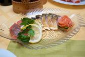 Dish with fish on table — Stock Photo