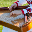 Stock Photo: Playing on harp