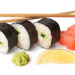 Three sushi, wasabi, gringer, lemon and sticks — Stock Photo #24876767