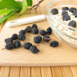 Muesli with dried aronia berries - Stock Photo