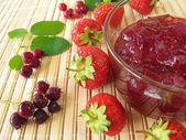 Jam with juneberries and strawberries — Stock Photo