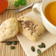 Red kuri squash soup with mini bread - Stock Photo