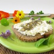 Bread and curd with spices and flowers salt - Stock Photo