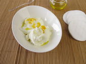 Face mask with cottage cheese, yogurt, olive oil and egg yolk — Stock Photo