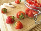 Sugared strawberries in jam jar — Photo