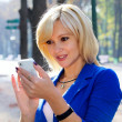 Beautiful lady using cellphone - Stock Photo
