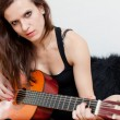 Stock Photo: The young woman and guitar