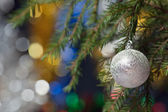 New Year's sphere on a fur-tree branch — Stock Photo