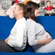 The man and the pregnant woman on a sofa — Stock Photo