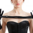 Woman in a corset and whip — Stock Photo