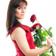 A woman with a red rose — ストック写真