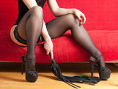 Woman in stockings and whip — Stock Photo