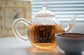 Teapot and cup on the window — Stock Photo