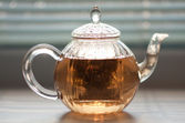 Teapot with green tea — Stock Photo