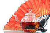 Teapot and a fan — Stock Photo