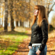 Woman with red hair in autumn park — Stock Photo
