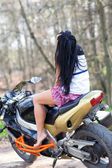 Girl sitting on a motorcycle — Stock Photo