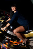 Girl sitting on a motorcycle at night — Foto de Stock