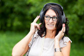 Adult woman in headphones — Stock Photo