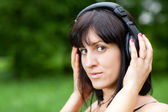 A young woman wearing headphones — Stock Photo