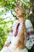 Girl near the tree — Стоковое фото