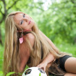 Woman and a soccer ball — Stock Photo