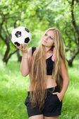 Woman holding a ball — Stock fotografie