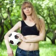 A woman holding a soccer ball — Stock Photo
