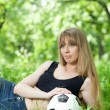 Stock Photo: Woman and a soccer ball
