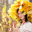 Woman in the autumn forest — Stock Photo