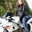 Woman sitting on a motorcycle — Stock Photo