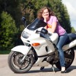 Stock Photo: Woman sitting on a motorcycle