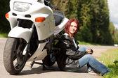 Woman near a motorcycle — Stock Photo