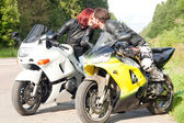 Man and woman on motorcycles — Stock Photo
