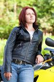 Woman standing near bike — Stock Photo