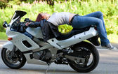 Woman lies on a motorcycle — Stock Photo