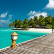 Jetty to a tropical beach — Stock Photo