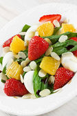 Spinach strawberry orange and quail eggs salad with almonds slices — Stock Photo