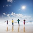 Friends holding togehter on beach — Stock Photo #16022577
