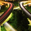 Traffic to city with blur motion car light — 图库照片