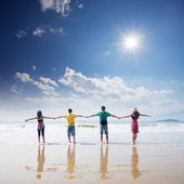 Friends holding togehter on beach — Stock Photo