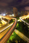 Traffic to city with blur motion car light — Stock Photo
