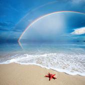 Rainbow with beach — Stock Photo