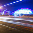 Light trails with the modern building — Stock fotografie