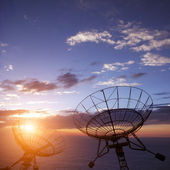 Satellite dishes with blue sky — Stock Photo