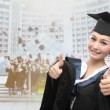 Asian graduate with big thumb — Stock Photo #16173529
