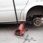 Changing a wheel of a modern car — Fotografia Stock  #16176845