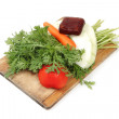 Vegetables on hopping block with white background — Stock Photo