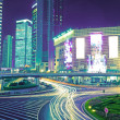 The light trails on the modern building background — 图库照片 #16178009
